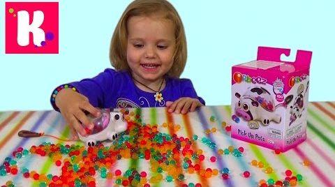 Видео Корова Орбиз c разноцветными шариками